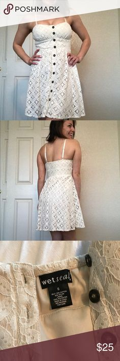 Very Cute Spaghetti Strap White Dress Doesn't have tags, but this dress has never been worn. (I was always a little self conscious about my boobs haha). It's off white, size small. Buttons go all the way down. I don't wear a bra with it (you really don't need one). Very comfortable. Great condition. Wet Seal Dresses Midi