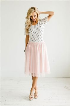 Love the polkadots and the Victorian pink skirt.