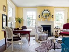 A hooked zebra rug once owned by decorator Albert Hadley takes pride of place in the living room of lighting designer Christopher Spitzmiller's upstate New York country home. The desk lamp is by Spitzmiller, as is the garden stool, which stands beside a Todd Alexander Romano floor lamp.