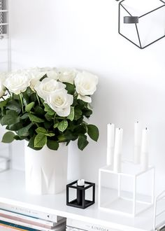 white roses and by Lassen Kubus 4 candleholder