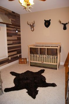 """This nursery shows a lot of creativity. I'm not a fan of animal heads on walls but these aren't real. Still I think I might go for an alternate. Over all I really like the thought that went into this and think this room would """"grow"""" with the baby very easily."""