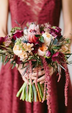 Gorgeous #Marsala Wedding Bouquet with protea, ranunculus, blue thistle and lotus pods / by Wallflower Designs / photo by Maggie Fortson Photography #peachranunculus