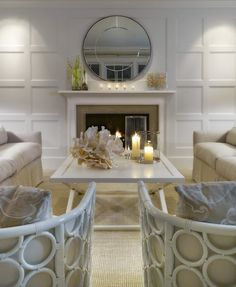 Paneled wall trim creates nice focal point wall with fireplace.