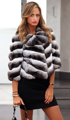 Chinchilla FurJacketwith whole skins. Made in Italy. Skins Quality: VELVET; Color: Black-Grey-White; Closure: With hooks; Collar: Round; Lining: 100% Satin; Lining Color: Fantasy, Multicolor; Length: 52 cm;