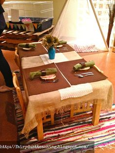 Reggio Emilia: Tables.  Love the beautiful Tipi in the back as well!