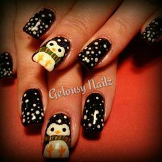 Penguin Christmas nail design.