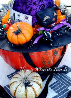 Witch hat on pumpkin table centerpiece for Halloween | homeiswheretheboatis.net