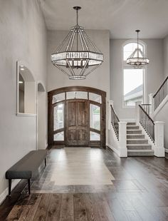 Foyer Lighting Trends hang beautiful organic pendants above each table to create a sea