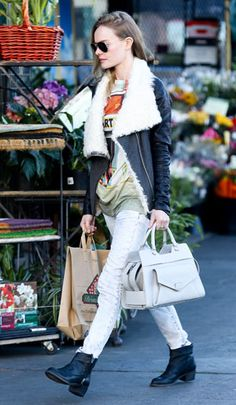 Kate Bosworth's sherling biker jacket and printed tee are a great nod to the glam-grunge trend.