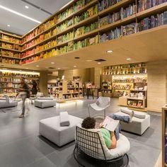 Suspended display table - Aiva bookstore by Studio Arthur Casas, Rio de Janeiro   Brazil bookstore