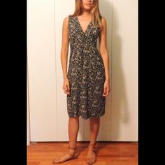 ASK! Free People floral dress Feel comfortable and free! This Free People find is a jersey type dress that ties in the back for more shape and a length that gracefully falls above the calves. (93% rayon 3% spandex) size fits like a s/m. Dress like the modern hippy beauty this summer! Free People Dresses