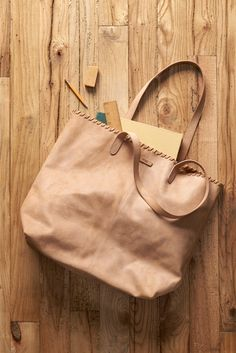 Click to shop this TOMS Distressed Leather Cosmopolitan Tote Bag in Cognac.