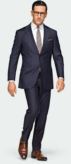 Always well received: Navy suit with cognac brown dress shoes. Notice the monk-strap style. We also like the worsted wool striped tie that compliments shoes and suit.