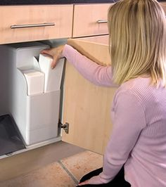 The Harvey water softener installed in the cupboard under the ...