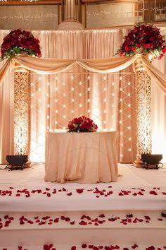Elegant cream decor, with beautiful, romantic red roses. #indian #wedding #stage