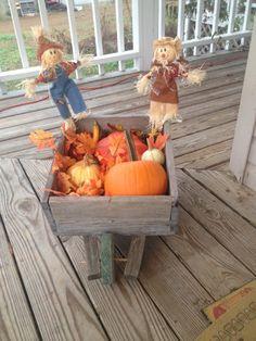 Fall wheelbarrow porch scene