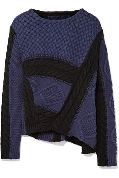 We asked MM6 Maison Margiela to tap into its archives to create a street style-inspired capsule collection just for us. Based on the label's best-selling pieces, the lineup includes a variety of knitwear including this chunky cable-knit cotton sweater. It has an asymmetric hem and cool black and midnight-blue colorway that will go with virtually anything.