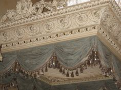 Crown Molding is a cornice with a Scrollwork design. This decorative molding is recommended for ceilings, and comes finished with White Primer. Bathroom Window Dressing, Bathroom Windows, Bed Crown Canopy, Accent Ceiling, Ceiling Decor, Ceiling Draping, Ceiling Canopy, Decorative Mouldings, Window Dressings