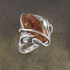 Cognac Amber Ring  In myth, it's the tear of goddess Freya, fallen into the sea. In fact, it's fossilized resin from trees that flourished millions of years ago. By either definition, this generous cabochon of cognac amber wins compliments with its openwork setting of antiqued sterling silver. Handcrafted in Poland. Whole sizes 6-9.  ****  Cognac Amber Ring  Item #:P41782  Price:$59.95