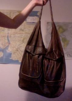 I love this bag. It is upcycled from an old leather jacket. I am so going to make this!