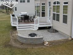 Deck leading to stone patio