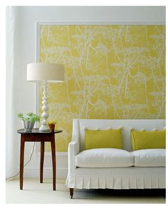 If you have a large blank wall that you don't know what to do with, consider framing up some wallpaper! Wallpaper comes in a wide variety and in all styles. And forget buying an expensive frame. Get some trim moulding cut to the proper size at Home Depot and paint it white. This makes for a dramatic (but inexpensive) piece of wall art. Cool, huh?
