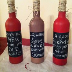 Painted wine bottles with chalkboard paper and twine:)