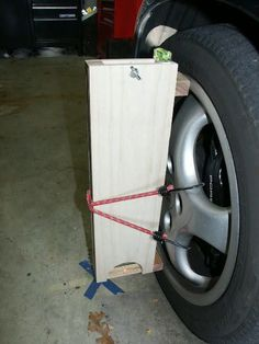 Laser Camber Gauge by Schocki -- Homemade laser camber gauge consisting of a laser plumb bob encased in a wooden box. Upper wood spacer is adjustable for different wheel sizes, while increments on the gauge are determined via tangential calculations. http://www.homemadetools.net/homemade-laser-camber-gauge