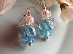 Check out this item in my Etsy shop https://www.etsy.com/listing/217967831/lampwork-earrings-aqua-earrings-shabby