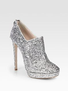 Miu Miu Glitter-Coated Platform Ankle Boots    these look like something my sister would wear