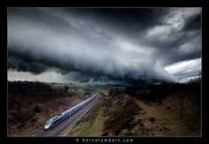 The French TGV train accompanied by a beautiful cloud structure. March 23, 2014