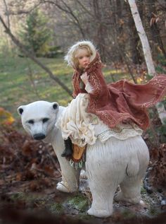 Based on the Norwegian Fairy Tale East of the Sun & West of the Moon. Bear & doll sculpted of polymer clay. The entire piece is 10-inches high x10-inches long including the base.