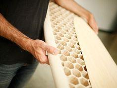 Toxin free wooden surfboard bears a striking honeycomb pattern
