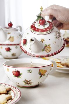 Christmas fruit tea for one stacking teset (teapot and cup) ... decorated with Christmas seasonal fruit and flowers, holly, white on red snowflake trim, cherry as knob, ceramic