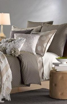 Spotted! Beautiful bedding with mixed patterns and textures.