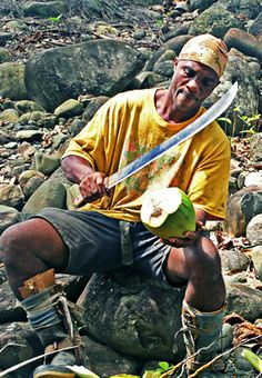 Splitting coconuts on the island of Dominica. Read about travel writer Andi Perullo's travels to the island.