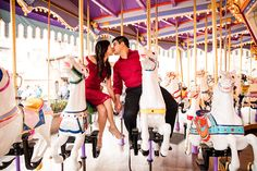A carousel kiss during an engagement portrait session at Disneyland. Photo: Jenna, White Rabbit Photo Boutique