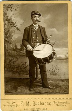 "Cabinet card of a cigar smoking drummer for the ""Union Band. Buchanan, Indianapolis, Ind"