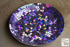 "Awesome DIY idea from Upcycle That – DVD Mosaics! They made a bird bath in this tutorial, but you can apply it anything you want. ""These were old computer backup discs that were no longer needed. The coolest part about this technique is cutting the DVDs into tiles. DVDs are made of 2 pieces of plastic with rainbow film in between."" ––– Prairie Gardens Champaign, Illinois  http://www.prairiegardens.com/"