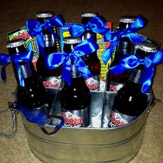 Birthday gift I made for my dad. Galvanized compartment bucket is from HomeGoods. I had leftover blue ribbon from my wedding. Used shredded paper to elevate the bottles, and slid lotto tickets in the back :o). Easy!