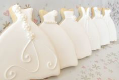Now...if they only had little icing shoes!   https://www.etsy.com/listing/128012099/1-dozen-signature-wedding-dress-cookies?ref=shop_home_active  #bridalshowerfavors #bridalshower #weddingfavors #weddingcookies #cookie favors #desserttable #desserttableideas
