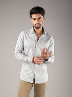 Alaska - ₹2,200/- Alaska gives a sober feel to the shirt with hints of light brown and grey in a lovely checkered patterning. #Shirts #Fabric #Prints #Classy #Collar #Handcrafted #Luxury #Perfect #Fit #Style #Handstitched #Fashion #Menswear #Womenswear #Style #Designer #Colours #Designs