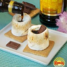 Kaluha Marshmellow Smores Shot- Your camping trip or backyard grill-out just got way more fun with these Kahlúa Marshmallow S'more Shots! Just toast a marshmallow, allow to cool, scoop out the center, pour in your favorite Kahlúa flavor, and add a mini chocolate bar garnish. #KahluaSummer