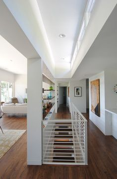 Modern Open Stairway Between Kitchen And Living Room