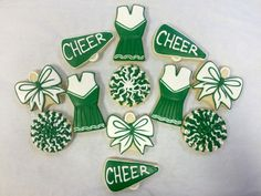 Awesome cheer cookies!  Www.cookiesbythecrate.com Www.ClawsonCookies.etsy.com Mail to: cookies@netonecom.net