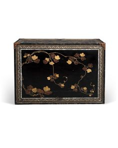 A Lacquer Cabinet Commissioned for the Portuguese Market on an English StandMomoyama period (late 16th century), English stand, late 18th - early 19th centuryThe rectangular cabinet with a drop front, opening to reveal 18 various-sized drawers surrounding a central drawer of architectural form, decorated in gold, silver and coloured hiramaki-e [low relief lacquer] and inlaid in mother-of-pearl on a black lacquered ground, the drop front with a cartouche enclosing a garden scene depicting…