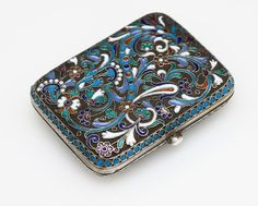 A Russian silver and cloisonne enamel powder compact, 1896 - 1908, with left-facing Kokoshnik, probably 84 standard, rounded rectangular form