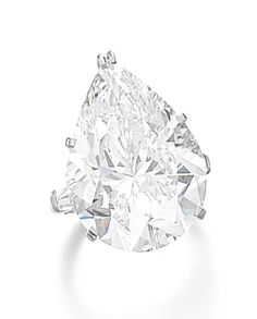 DIAMOND RING, HARRY WINSTON Featuring a pear-shaped diamond weighing 23.63 carats, set between tapered baguette diamond shoulders, size 48, signed Winston.