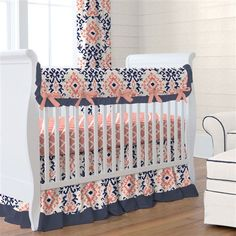 Navy and Coral Ikat Crib Bedding by Carousel Designs.  This classic Ikat design features rich shades of Coral and Navy on a cream background. This timeless fabric creates the perfect nursery design for your little one. So many decorating options with this stunning collection.