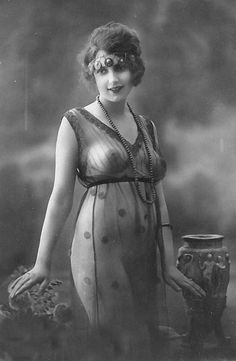 1920's photograph of a flapper in a sheer dress